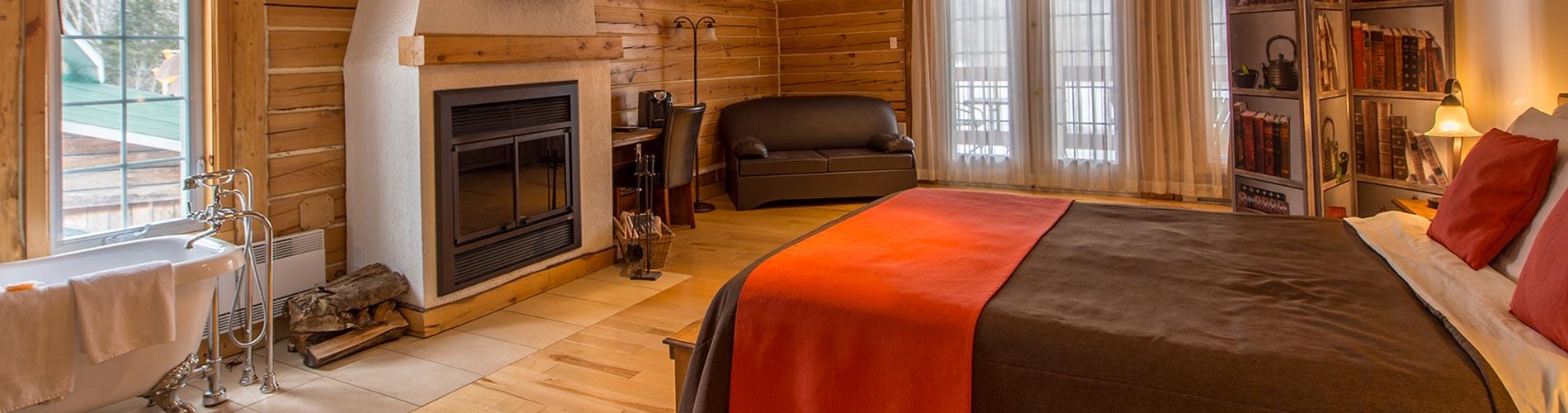 Bannière Chambre luxueuse avec foyer au bois & bain sur pattes